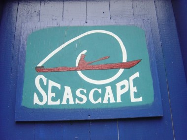 SIGN ON BLUE DOOR OF SEASCAPE SHOP.