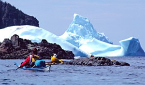 Kayaking near iceberg.