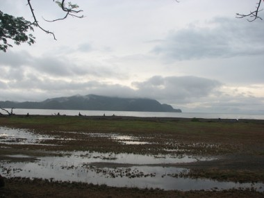 Playa Tambor after a hard rain, with its view of the silent sentinel, the land formation locals call a crocodile.