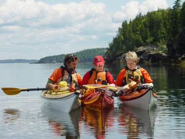 GUIDES CONSULT NAVIGATIONAL CHART OF THE BAY OF FUNDY TO PLAN THEIR ROUTE DURING STAFF TRAINING 2009.