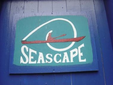 SIGN ON BLUE DOOR OF SEASCAPE SHOP.