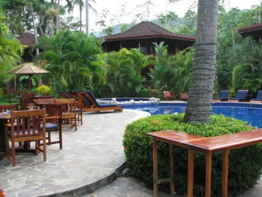 THE POOL AND RESTAURANT AT THE HOTEL TAMBOR TROPICAL